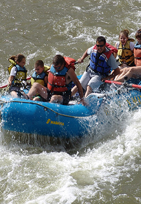 White-water rafting on the Rio Grande in a blue, rubber raft