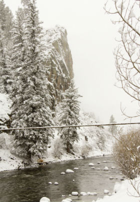 cliffs and river covered in winter snow