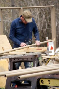 man in baseball cap welding